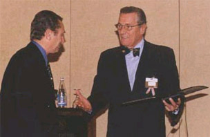 Jean-Pierre Farcy accepting an award
